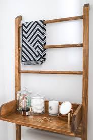 boost your bathroom storage with a diy ladder shelf leaning