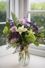 green and purple vase arrangement in newport or newport florist