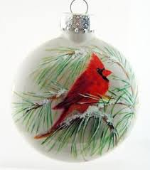 ornament cardinals on branches snowing painted