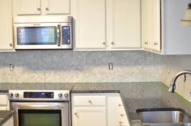 white herringbone backsplash cabinet espresso color under counter