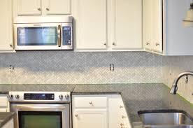 white herringbone backsplash cabinet espresso color under counter