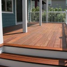 simple patio deck with behr solid deck stain and blue wooden