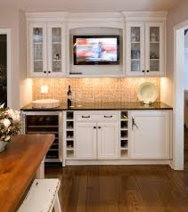 tv in kitchen between full size refrigerator and full size freezer