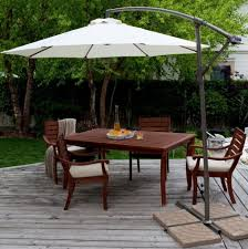 Patio Umbrellas Clearance by Decorating Alluring Red Costco Patio Umbrella With Blue Chairs