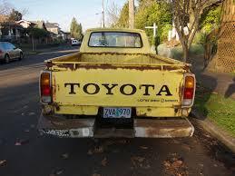 yellow toyota truck the street peep 1978 toyota hilux