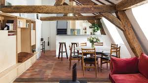 this attic apartment in paris is a curious package of all things