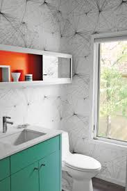 in the new powder room jill malek wallpaper adds graphic punch to