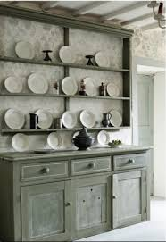 old dresser painted by annie sloan in chateau grey chalk paint