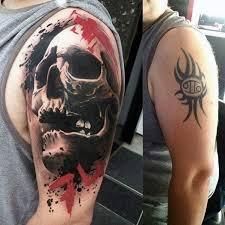 mens tribal cover up tattoo on arm with 3d skull design legacy