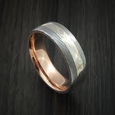 mokume gane damascus steel and mokume gane ring with 14k gold sleeve
