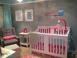 baby gray nursery ideas grey arcmchair white metal crib white
