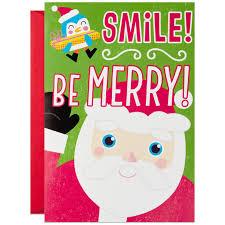 santa claus hugging musical card for child greeting