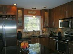Medium Brown Kitchen Cabinets by Adel Medium Brown Cabinets With A Eye Catching Backsplash Ikea