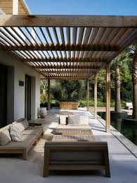 modern patio backyard long paio with wooden furniture and sunspot at the