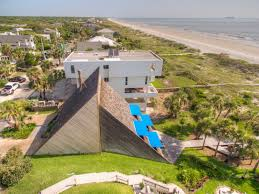 home design florida triangular beachfront home is a dreamy retreat buried in the earth