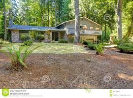 house in the woods summer time in washington state stock photo