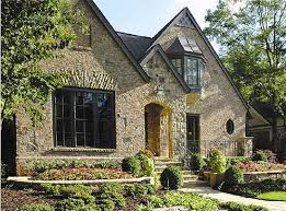 european cottage house plans thin wooden shutters and carriage style garage door poplars