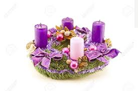 advent wreath decorated with purple candles and christmas