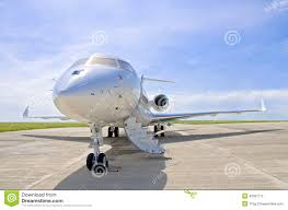 luxury private jet airplane side view bombardier global stock
