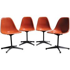 eames for herman miller orange fiberglass swivel shell chairs at