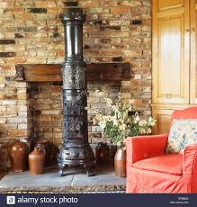 Victorian Style Living Room by Black Cast Iron Victorian Style Stove In Brick Fireplace Of