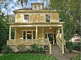 yellow foursquare house yellow clapboard house with cream trim