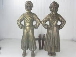 antique dutch boy and andirons brass andirons iron firedogs
