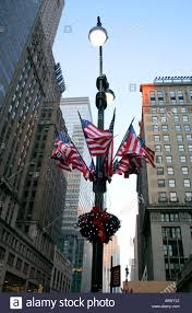 american flags on l post new york city lights and stock