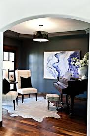 formal sitting room with metallic cowhide rug navy walls grand