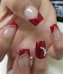 square shaped acrylic nails v shaped red polish on tips with