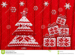 christmas tree and gift shapes cut from knitted pattern royalty