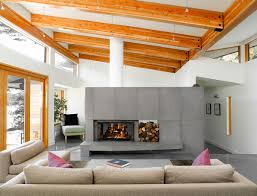 solus concrete wall tiles used for a double sided fireplace a