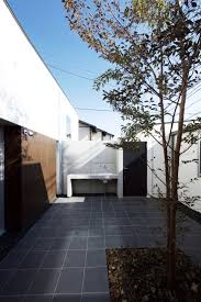 u shaped house with outdoor patio courtyard in the center by