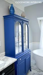 repurposed china cabinet as bathroom storage clockwork interiors