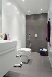 bathroom white hanging vanity white toilet grey tile flooring