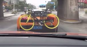 lamborghini bicycle using a lamborghini gallardo u0027s bumper to carry a bicycle is