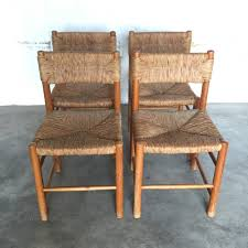 set of 4 french pine chairs by charlotte perriand for sentou