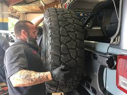 jeep tire carrier the jk alpha hd hinged teraflex tire carrier jeepsies