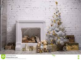 white christmas tree with golden and silver balls gift boxes