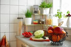 kitchen interior with small shelf with pot herb and kitchen