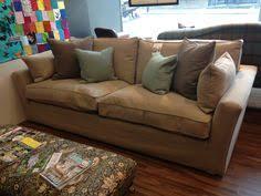 Grande Dame Sofa Storyteller Chair In Ingleton Logan With Earth Turquoise Bolster