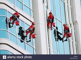 window cleaners cleaning windows modern office tower high rise