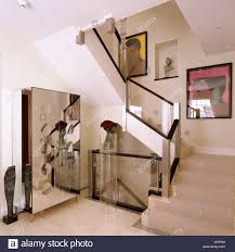 Banister Staircase And Hall With Contemporary Artwork And Glass Banister In