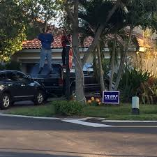 halloween city miami fl dummies lynched next to trump sign in miami miami new times