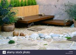 roof garden bamboo fence white boulders cedar deck and seats