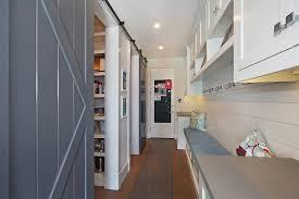 Overhead Barn Doors Mudroom With Gray Barn Doors Cottage Laundry Room