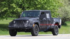 jeep truck spy photos new jeep wrangler pickup spy shots reveal suspension and tire