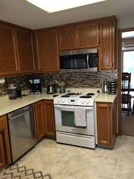 how to put up tile backsplash in kitchen vinyl smart tiles to update my kitchen hometalk