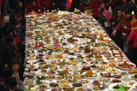 table full of food food eating together eat well for less diversity in different
