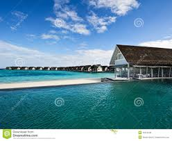 over water house and swimming pool in beach resort stock photo